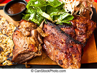 Grilled steak - Grilled meat ribs on the plate with hot...