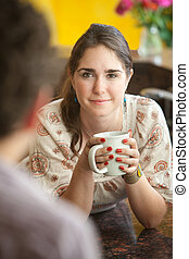 Woman With Coffee Mug - Beautiful young woman with friend...