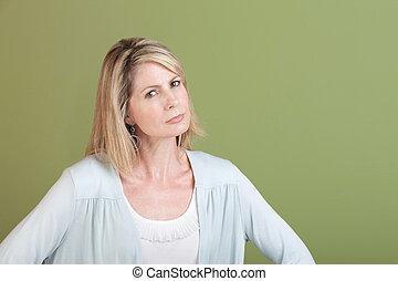 Suspicious Woman - Suspicious mature Caucasian woman over...