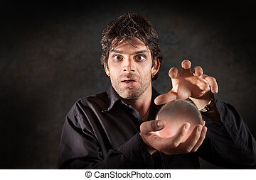 Fortuneteller With Crystal Ball - Fortuneteller gazes...