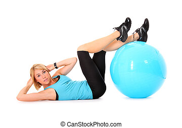 Sit-ups with ball - A picture of a beautiful young woman...