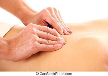 Massage - A picture of male hands giving a back massage over...