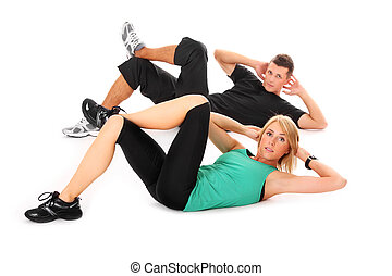 Sit-ups - A picture of a young couple doing sit-ups over...