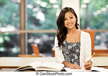 Asian student studying - A shot of an Asian student studying...