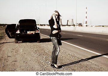 Young woman calling for help - Young blonde with a broken...