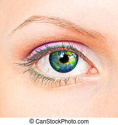 Earth eye - Close-up of beauty female eye with Earth inside