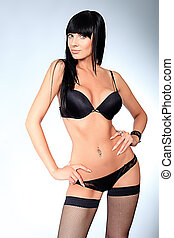 black lingerie - Shot of a sexy woman in black lingerie over...