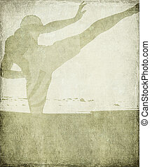Martial Arts Silhouette on Chalky Grey Grunge Background...