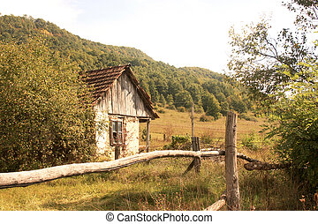 abandoned old house - Wooden fence against abandoned old...