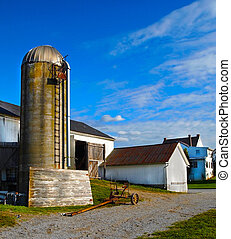 Silo and Sky - An old cement silo with a barn, a farmhouse,...