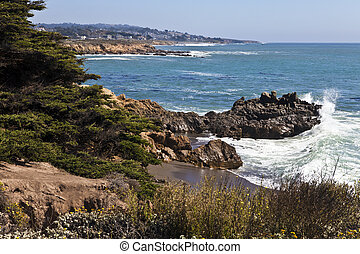 Rugged Moonstone Beach - Surf crashes against the rugged...