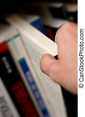 Hand taking book