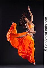 beauty dancer jump in orange veil - arabian style - beauty...