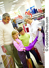Family in the mall - Portrait of happy grandparents and...