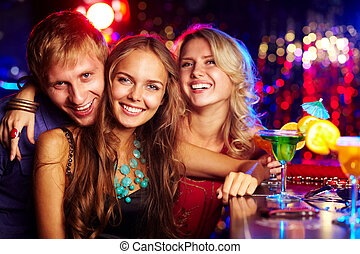 Company of clubbers - Image of happy friends looking at...