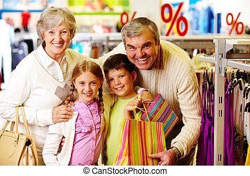 Happy customers - Portrait of happy grandparents and...