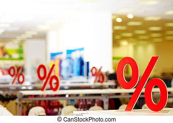 On sale - Sign of discount in clothing department during...