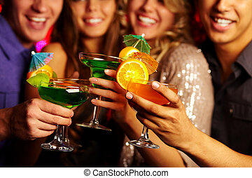 Holding cocktails - Close-up of several cocktails in young...