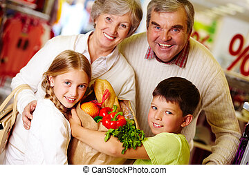 After shopping - Portrait of happy grandparents and...