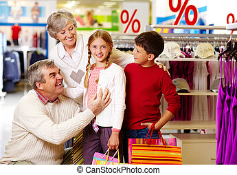 Family shopping - Portrait of happy grandparents and...