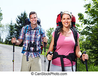 Hiking couple. - Young happy couple hiking at the park.