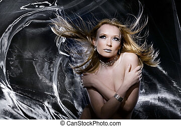 Silver nude - Nude girl in studio with silver cloth blowing...