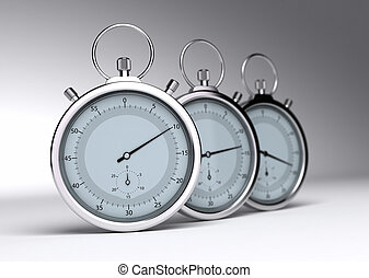 three stopwatches over a grey background with blur