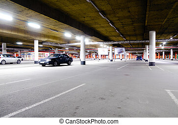 mall underground parking - underground parking garage, with...