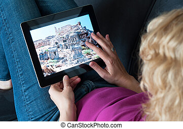 Middle-aged woman with digital tablet pc