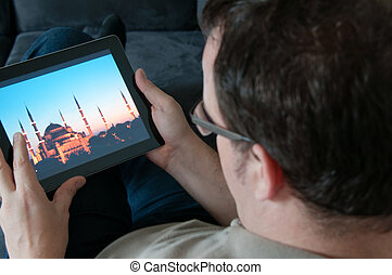 Middle-aged man with digital tablet pc