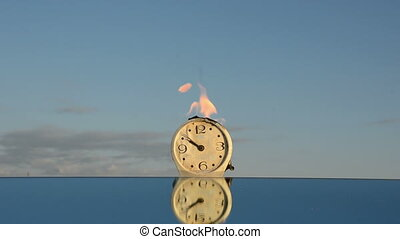 burning clock on mirror
