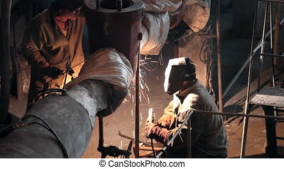 welders at work close up