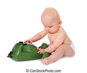 Baby - Newborn child playing with a green telephone All...