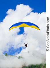Parachuter descending in Himalaya - Parachuter descending...