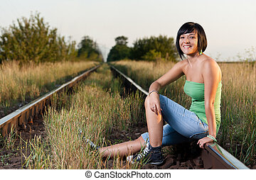Railroad  - A girl sitting on the railroad