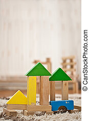 wooden toy blocks construction on carpet