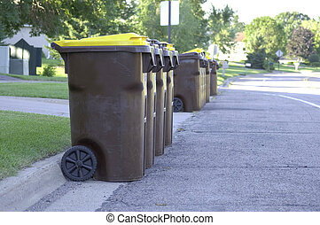 Garbage Day - A group of Garbage cans on the side of the...