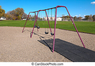 Swing Set - a four swing swingset at a playground / park