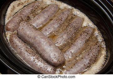 Beer Brats in a Crock Pot - Bratwurst in a crock pot cooking...