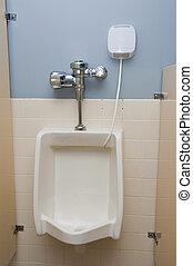 Urinal - A very clean urinal in a bathroom