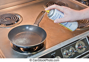 Frying Pan Spray - Spraying down a hot frying pan with...