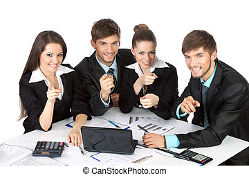 business people - young business people sitting at desk all...