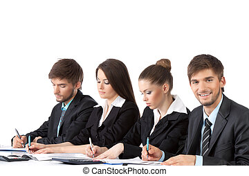 business people - young business people sitting in row at...