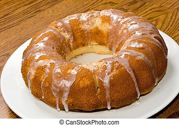 Lemon Pound Cake - A Lemon Pound Cake on top of a White...