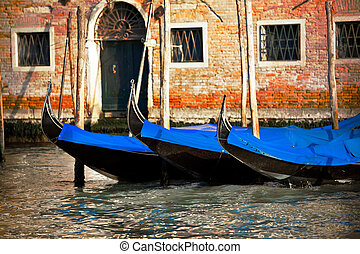 Gondolas in Venice city, Italy - Details of gondolas in...