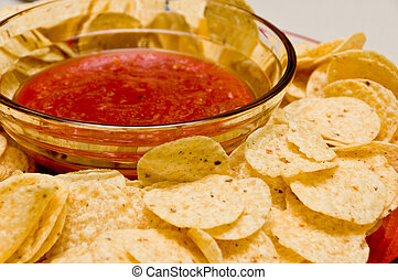 Chips and Salsa - Tomato Salsa and Tortilla Chips on a plate