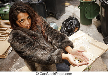 homeless woman asking charity
