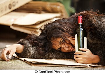 drunk tramp woman holding bottle of wine and lying on...