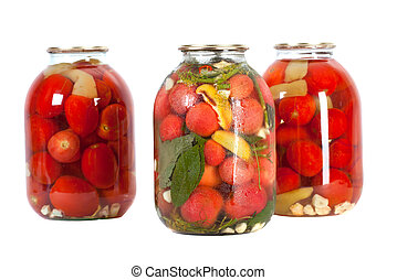 red tomatoes in a glass jar - Preserved red tomatoes in a...