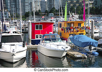 Boat houses in downtown Vancouver BC Canada - Colorful...